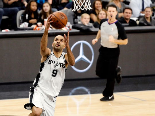 San Antonio Spurs point guard Tony Parker (9) shoots