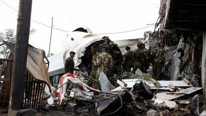 The wreckage of the Fokker 50 cargo plane after it crashed on takeoff at Kenyatta International Airport, in Nairobi, Kenya, Wednesday, July 2, 2014. Cargo Four people were killed when their cargo plane crashed shortly after takeoff in Nairobi, a police official said Wednesday. The plane transporting the mild stimulant known as Khat to the Somali capital, Mogadishu, crashed into a commercial building after taking off from Jomo Kenyatta International Airport early Wednesday, said Joseph Ngisa, the airport's head of police investigations.