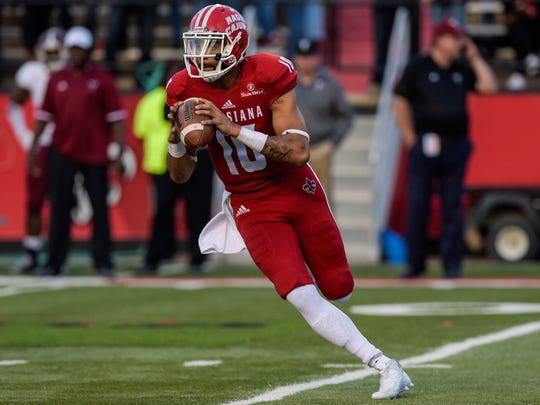 UL  quarterback Jordan Davis (10), shown here rolling out against Troy last season, goes in 2014 spring practice competing with Chris Weaver for the No. 1 job.