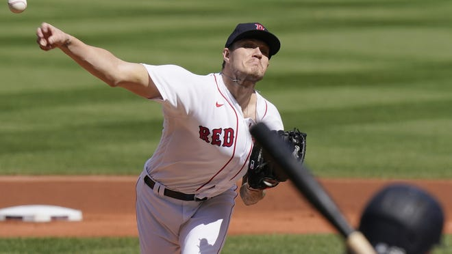Boston Red Sox starting pitcher Tanner Houck delivers a pitch against the New York Yankees in the first inning of a game on Sunday in Boston. It was Houck's first ever start at Fenway Park.