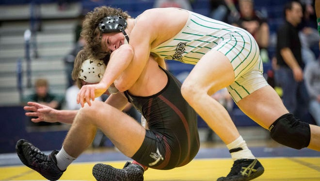 Colt Rutter with Yorktown grapples with Wes-Del's Dylan Torbush during finals of the Delta Sectional championship Jan. 28 at Delta High School. Rutter won the match 9-3, with Yorktown taking first overall with a final score of 307.5.