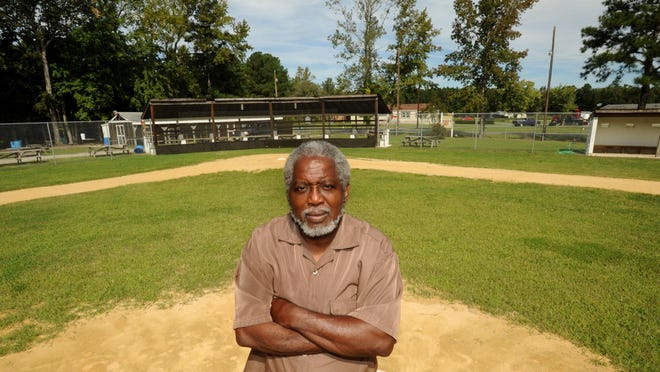 Kirkland Hall, formerly of the Oaksville Eagles baseball team, stands on the pitcher's mound at one of the few surviving sandlot black baseball fields on the Eastern Shore.