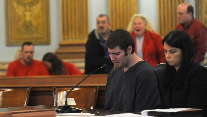 Logan Terry bows his head as the mother of Christopher Byerly addresses the court, stating that she will never forgive Terry for taking her son. Terry entered a guilty plea for reckless homicide in court on Friday.