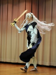 """Laci Davis, dressed as Corrin, from the video game """"Fire Emblem"""" shows off her costume on stage in the adult costume contest at LibCon on Saturday, May 6, 2017, at the main branch of the Abilene Public Library."""