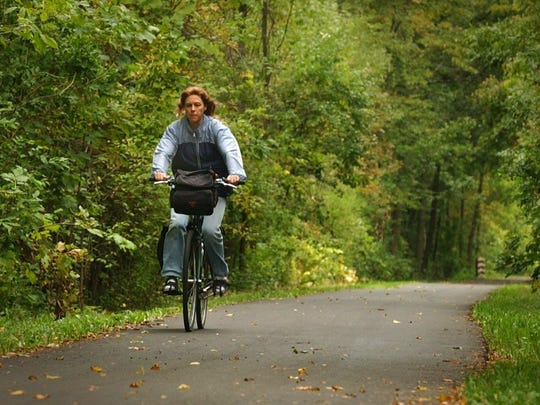 A cyclist takes a spin the Ozaukee Interurban Trail.