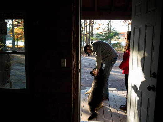 Donnie Davis of Amazing Grace Ministries pets his dog