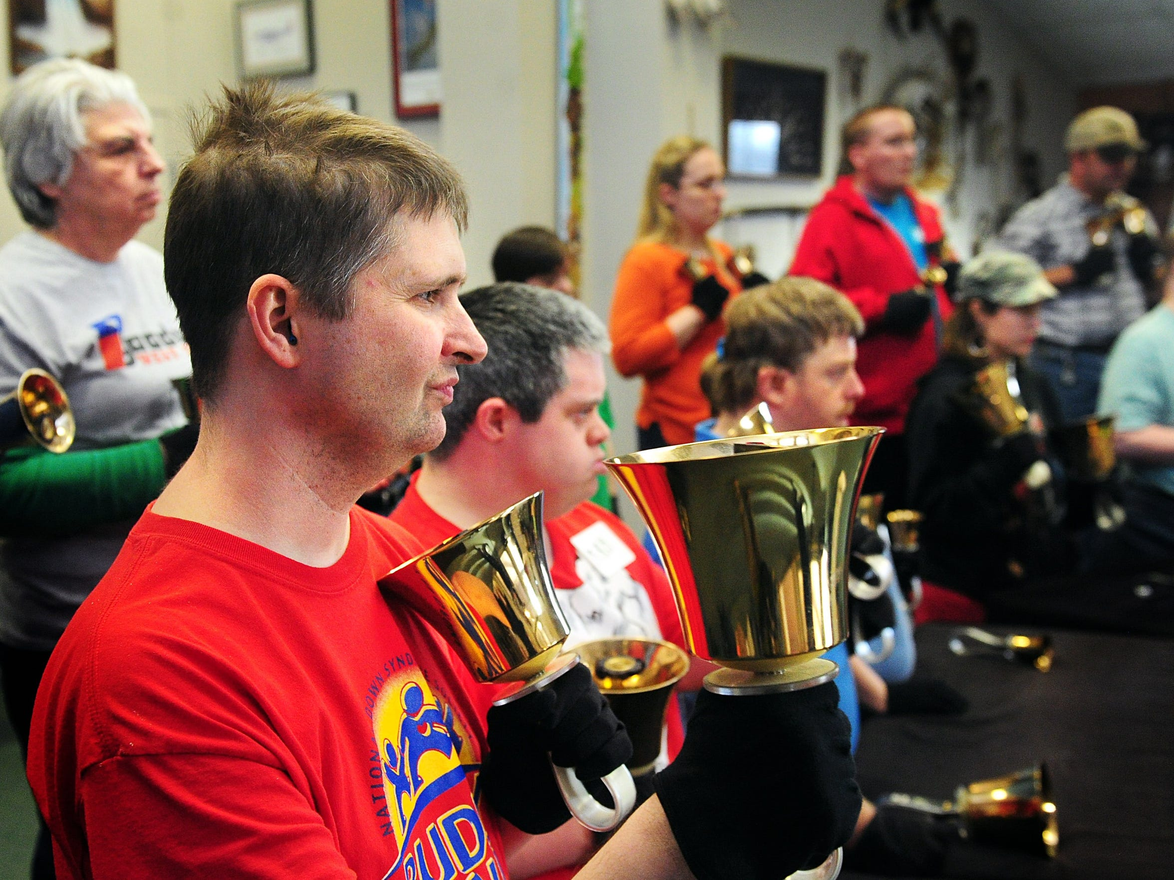 Bell Pepper Handbell Choir member Chris Shields, left, joins in to rehearse a song for the Disability Resources Inc. Big Country Christmas Concert in 2013 at Disability Resources Inc.