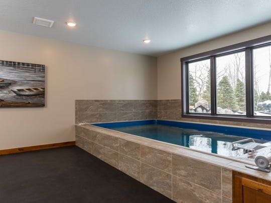The recessed indoor Endless Pool is 4.3-feet deep and can also double as a hot tub.