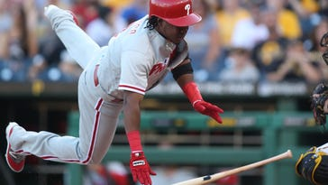 Phillies third baseman Maikel Franco reacts after being hit by a pitch from Pirates pitcher Gerrit Cole Friday night.