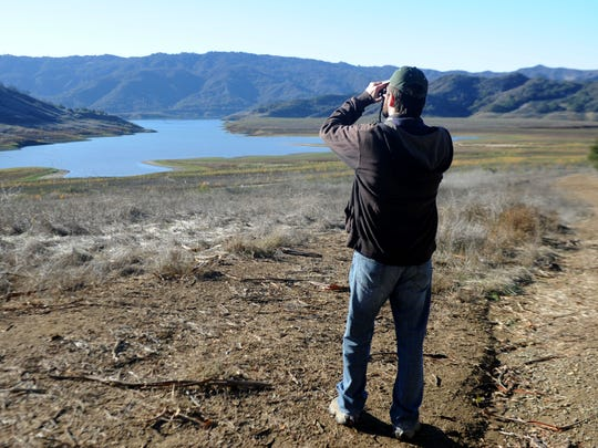 Frank DeMartino, of Ventura, counts the birds at Lake