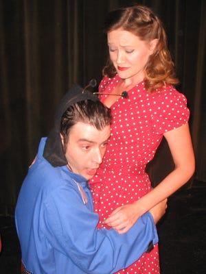 "Jorndav (Matt Hall) seeks comfort from Mrs. Smith (Sarah Roberts) in ""Alien in the Attic."""