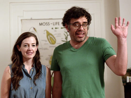 Stephanie Allynne and Jemaine Clement in a scene from