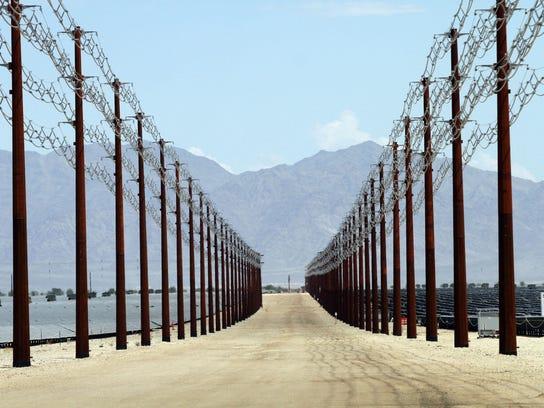 Overhead transmission lines funnel power underground
