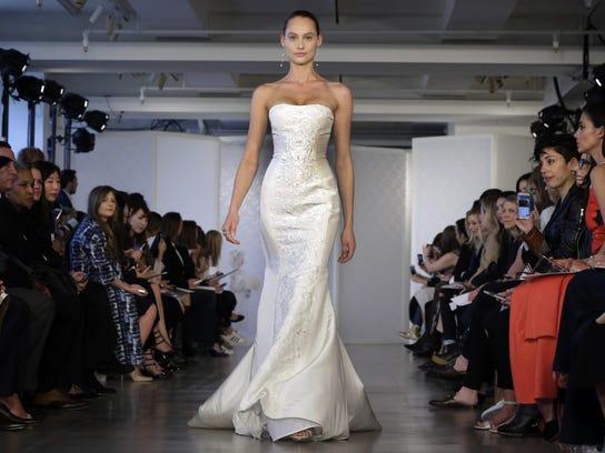 A sleek wedding gown in the Oscar de la Renta Bridal
