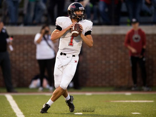 Maryville's Dylan Hopkins looks for an open receiver