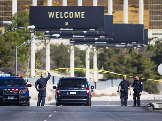 Police allow a vehicle to pass a roadblock on Las Vegas