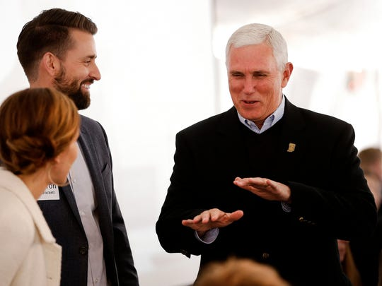 Indiana Governor Mike Pence, right, talks with Traders Point Christian Church pastor Aaron Brockett prior to the groundbreaking ceremony of the new Traders Point Christian High School's phase one, which includes a new 21st century academic facility and turf athletic field on May 15, 2016.
