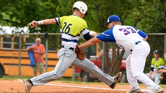 Staunton Braves first baseman Austin Edens tags out Charlottesville TomSox's Seth Lancaster on  pickoff play during their game June 19.