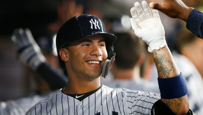 Jun 14, 2018; Bronx, NY, USA;  New York Yankees second baseman Gleyber Torres (25) celebrates in the dugout after hitting a three run home run against the Tampa Bay Rays at Yankee Stadium.