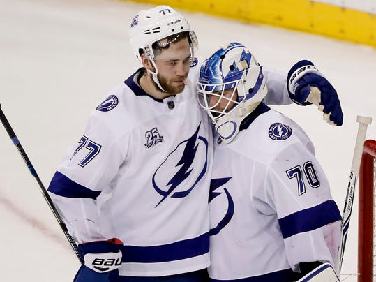 Tampa Bay Lightning defenseman Victor Hedman (77) celebrates with goaltender Louis Domingue (70) after the Lightning beat the New York Rangers in an NHL hockey game, Friday, March 30, 2018, in New York. (AP Photo/Julie Jacobson)