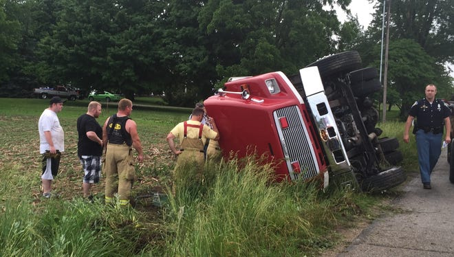A Fountain City firefighter received minor injures when an engine rolled over in an accident. The stormy weather is believed to have played a role in the incident.