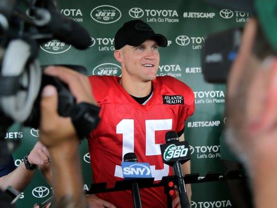New York Jets quarterback Josh McCown talks to reporters