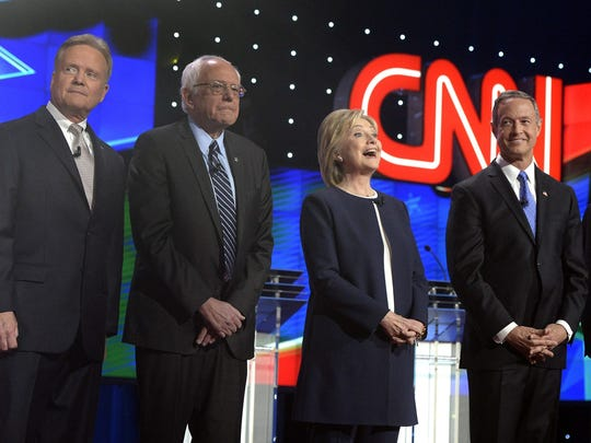 Hillary Clinton was literally and figuratively the center of attention during Tuesday's Democratic presidential debate.