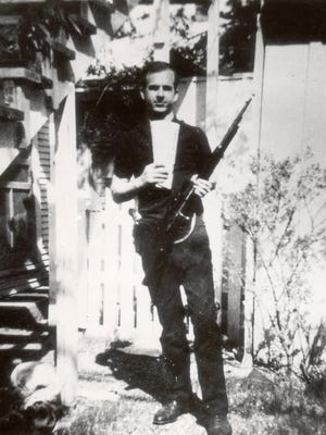 Lee Harvey Oswald in the backyard of his Dallas apartment home in April 1963.