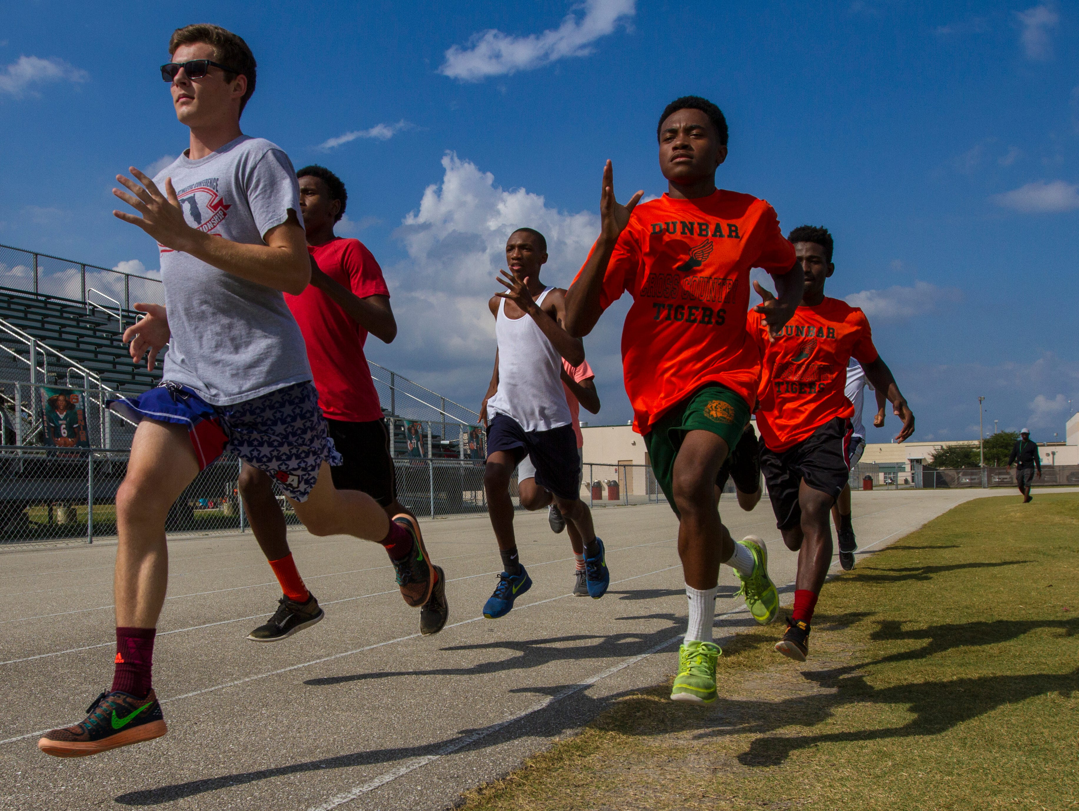 Members of the Dunbar High School cross country team practice after school Wednesday, November 2, at their track in Fort Myers. The team has qualified for its first state championship in school history.