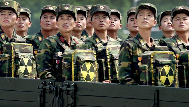 "In this 2013 photo, North Korean soldiers turn and look toward leader Kim Jong Un as they carry packs marked with the nuclear symbol as they parade during a ceremony marking the 60th anniversary of the Korean War armistice in Pyongyang, North Korea. The United States, South Korea and Japan agreed to launch a ""united and strong"" international response to North Korea's apparent fourth nuclear test, as experts scrambled Thursday, Jan. 7, 2016, to find more details about the detonation that drew worldwide skepticism and condemnation."