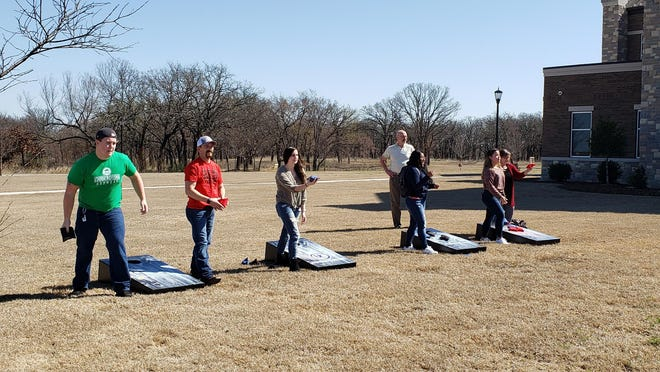 USCO students play a round of corn hole Thursday afternoon. The new corn hole bords were provided courtesy of the Ardmore Institute of Health as part of an initiative to encourage a physically active lifestyle.