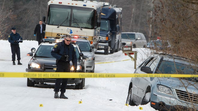 Michigan State Police investigate the scene where Matthew Lundy was fatally shot by Eaton County Sheriff's deputies near Eaton Rapids on Feb. 17. Eaton County Prosecutor Doug Lloyd is expected to announce today if he'll seek charges against the deputies.