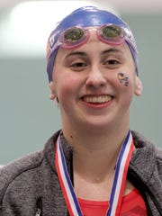 Lucy Callard of Seven Hills wins the 500 yard freestyle.