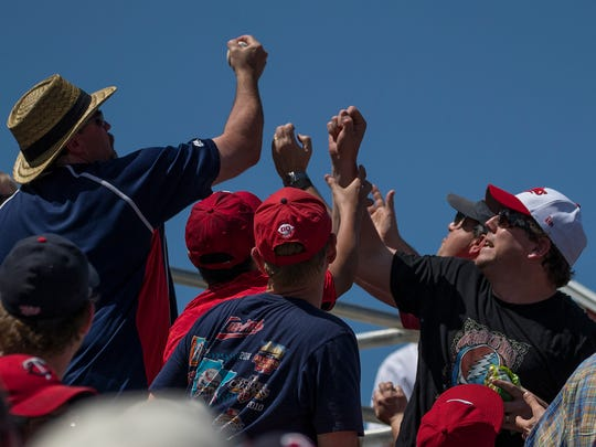 Minnesotta Twins fans compete over a foul ball at CenturyLink Sports Complex in Fort Myers Tuesday afternoon during the matchup against the Tampa Bay Rays.