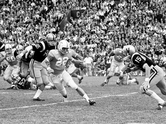 Tennessee wingback Richmond Flowers (22) attempts to move away from charging Vanderbilt safety Bernie Kemple (15). Tennessee won 28-0 for their seventh win of the season before 26,882 at Dudley Field Nov. 26, 1966.