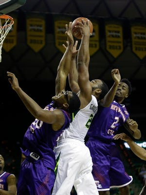 Baylor Bears forward Rico Gathers (2) rebounds against Northwestern State Demons forward Ishmael Lane (20) and guard Ta' Jon Welcome (2) at Ferrell Center.
