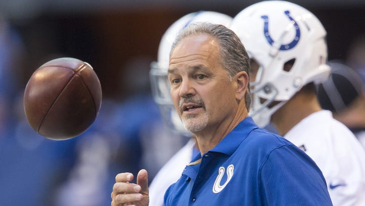 Chuck Pagano helps the defense run a drill during Colts open practice mini camp at Lucas Oil Stadium, Indianapolis, Wednesday, June 8, 2016.
