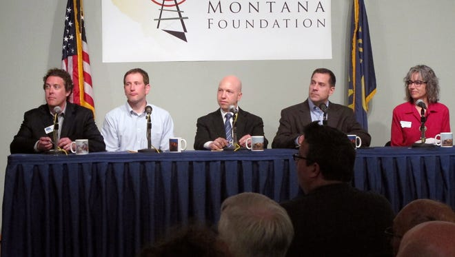 In this May 3, 2018, photo five Democratic candidates for Montana's U.S. House seat from left, John Heenan, John Meyer, Jared Pettinato, Grant Kier and Kathleen Williams listen to a question during a candidate forum in Helena, Mont. (AP Photo/Matt Volz)