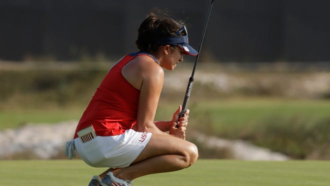 Gerina Piller of the United States reacts to missing a birdie putt on the 18th hole during the third round of the women's golf event Friday at the 2016 Summer Olympics in Rio de Janeiro.
