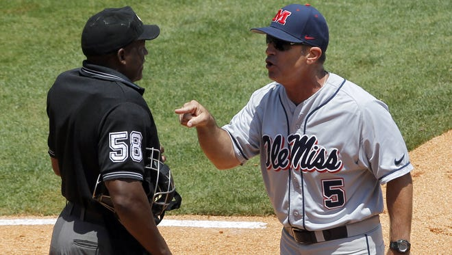 Mississippi's head coach Mike Bianco argues with umpire David Brown after a call during the seventh inning in a game against Vanderbilt at the Southeastern Conference NCAA college baseball tournament on Thursday, May 22, 2014, in Hoover, Ala. (AP Photo/Butch Dill)