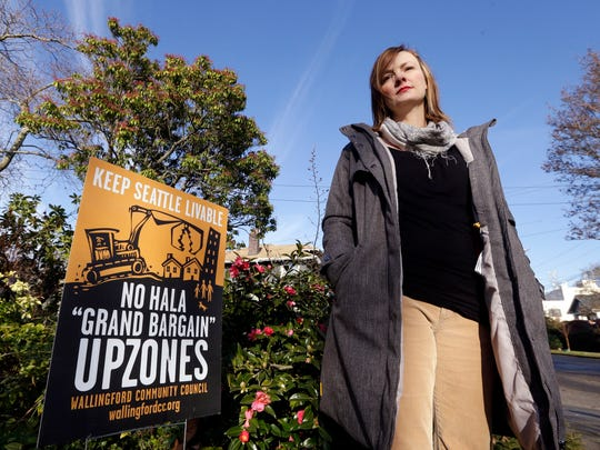 Susanna Lin, a member of a neighborhood group opposed to a proposed development plan, stands in her neighborhood in Seattle.