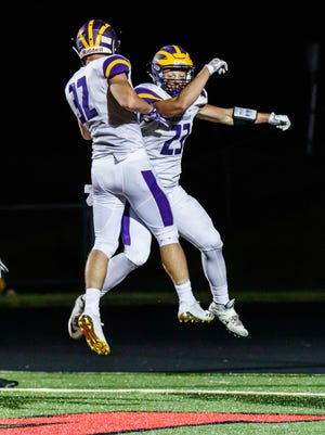 New Berlin Eisenhower junior Jack Himmelspach (right) celebrates a touchdown with teammate Joe Lang (32) during the game at Pewaukee on Friday, Aug. 25, 2017.