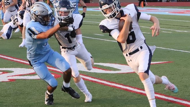 Greenwood's LD Richmond runs for the sideline behind the block of Caden Brown, Friday, Sept. 4, during first quarter action at Jim Rowland Stadium.