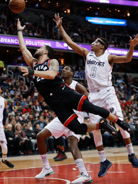 Toronto Raptors guard Fred VanVleet (23) drives past Washington Wizards center Ian Mahinmi (28) and guard Tim Frazier (8) during the first half of an NBA basketball game Friday, March 2, 2018, in Washington. (AP Photo/Pablo Martinez Monsivais)
