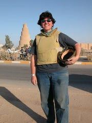 Milwaukee Journal Sentinel reporter Meg Jones stands outside the minaret of a 8th-century mosque in Samarra, Iraq, in June 2005.
