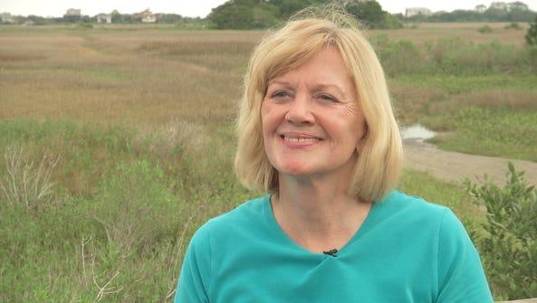 Historical Archaeologist Kathleen Deagan stands on