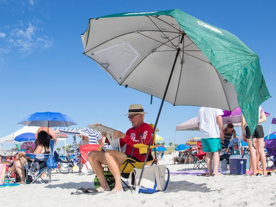 TIP: Umbrellas help beat the heat, but you must leave