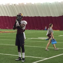 Paul Crawford takes a breather at ASU football practice inside the Dickey Dome in Tempe.