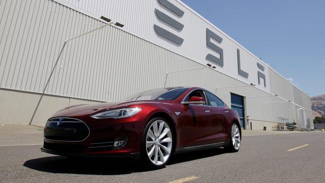 A Tesla Model S driving outside the Tesla factory in Fremont, Calif.