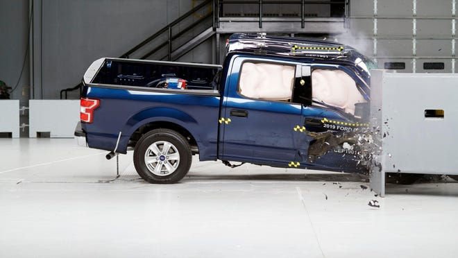 Action shot taken during the passenger-side small overlap frontal crash test of the 2019 Ford F-150 SuperCrew.